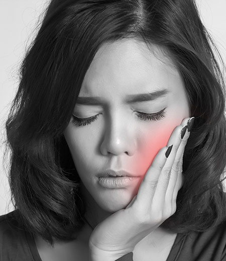 A woman suffering from toothache